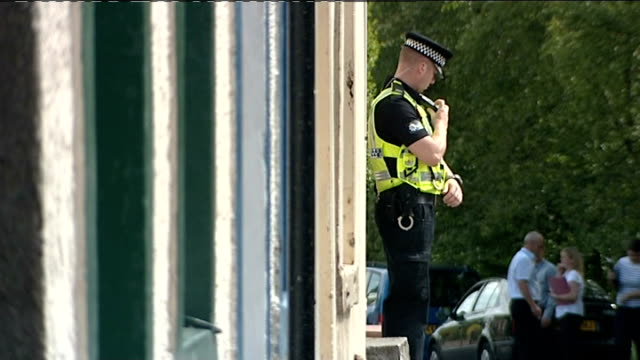 derrick bird was legal owner of guns rowrah general views of police officers standing guard outside house where derrick bird lived - derrick bird cumbria stock-videos und b-roll-filmmaterial