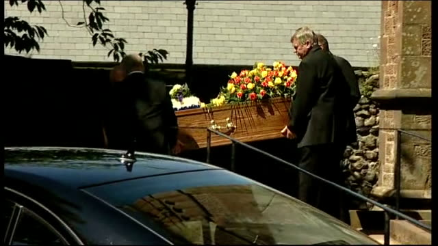 funerals held for three more victims coffin of isaac dixon being carried along outside church - derrick bird cumbria stock-videos und b-roll-filmmaterial