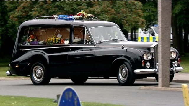 funerals of victim and derrick bird take place england bedfordshire ext hearse carrying coffin of jamie clarke along to funeral - derrick bird cumbria stock-videos und b-roll-filmmaterial
