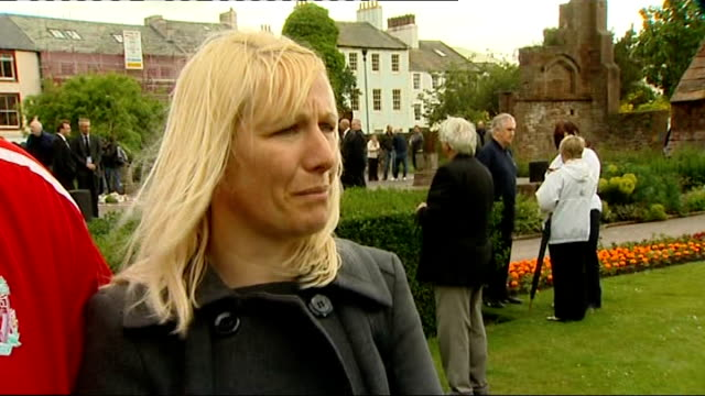 memorial services held across west cumbria joanne bell and unidentified man chatting to reporter joanne bell interview sot don't blame family of... - derrick bird cumbria stock-videos und b-roll-filmmaterial