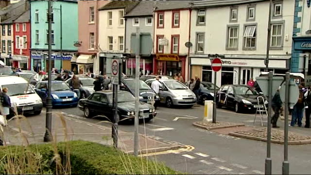 memorial services held across west cumbria whitehaven wide shot of taxis at taxi rank blasting horns at end of minute's silence sot women standing in... - taxi rank stock videos & royalty-free footage