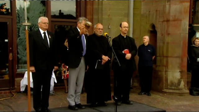 vídeos de stock e filmes b-roll de memorial services held across west cumbria whitehaven woman attending remembrance service man ringing bell at start of minute's silence at noon sot... - meio dia