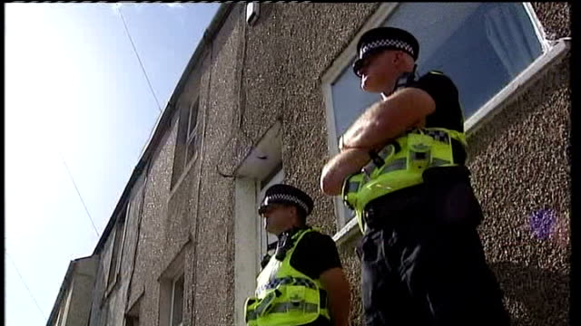 profile of gunman derrick bird england cumbria rowrah ext police on guard outside home of derrick bird - derrick bird cumbria stock-videos und b-roll-filmmaterial