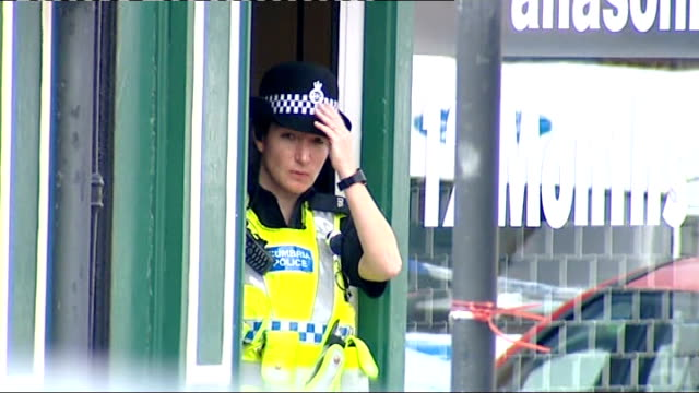 whitehaven shooting aftermath england cumbria whitehaven ext various shots of police officers and police cars in cordoned off high street scene of... - derrick bird cumbria stock-videos und b-roll-filmmaterial