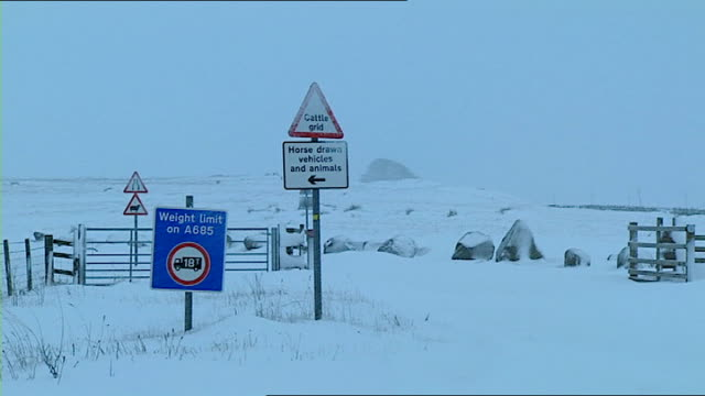 snow in village of shap / traffic on roads in snowy conditions lorry along / snow covered fields and sign to orton / slush in road and snowy fields... - snow vehicle stock videos and b-roll footage