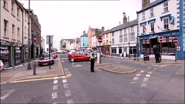 cumbria whitehaven ext general view of cordonedoff road following shooting car behind railings - cumbria stock-videos und b-roll-filmmaterial