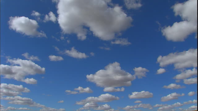 Cumulus clouds move slowly across the sky.