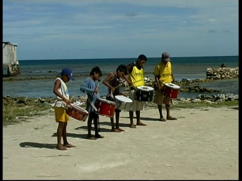 Cuna children playing drums, MS, Panama, Central America