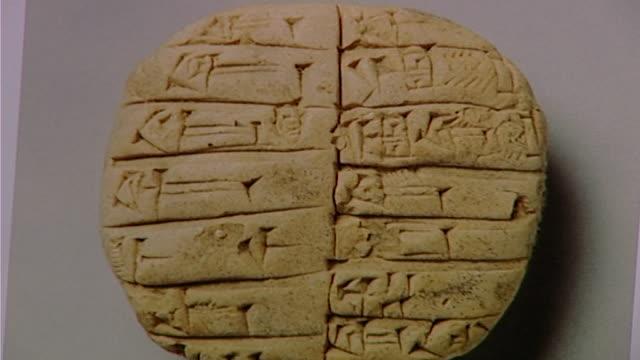 cuneiform seal. close up of clay seal with cuneiform script. - lehm mineral stock-videos und b-roll-filmmaterial