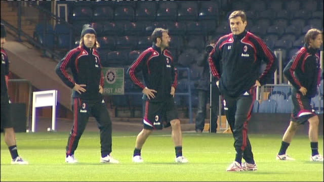 ac milan squad training more of milan players stretching on pitch mid shot of ronaldinho more of milan players training including filippo inzaghi... - andrea pirlo stock videos & royalty-free footage
