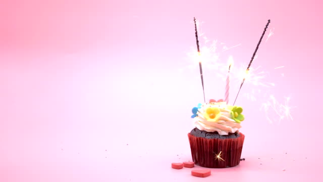 cup cake on pink background - muffin stock videos and b-roll footage