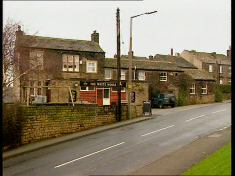 emley; itn england: yorks: emley: ext almost deserted streets of emley emley supporters gathered with team before the teams departure for london to... - itvイブニングニュース点の映像素材/bロール