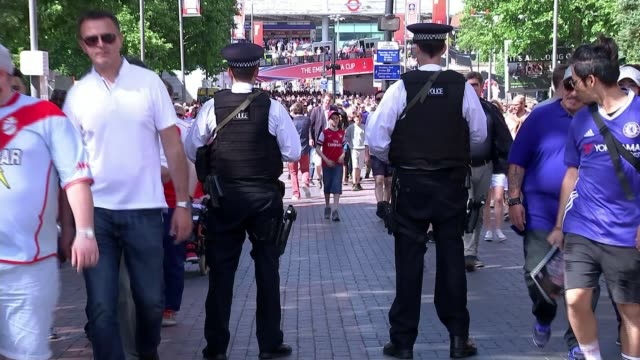 Arsenal beat Chelsea amidst tighter security ENGLAND London Wembley EXT Arsenal and Chelsea fans arriving for FA Cup final as pass armed police on...