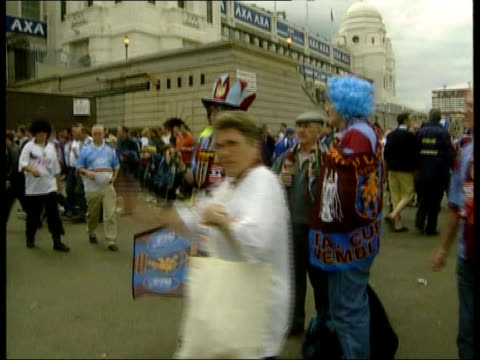 chelsea win england london wembley stadium twin towers of wembley stadium tilt down football fans milling around aston villa supporters playing up to... - wembley stock-videos und b-roll-filmmaterial