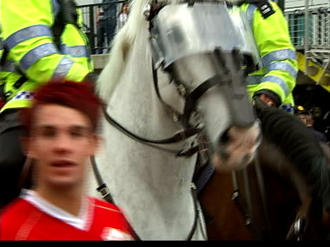 fans arriving at wembley stadium; manchester united fans singing and acting up for camera as chelsea fan jumps in front of camera waving flag fans... - final round stock videos & royalty-free footage