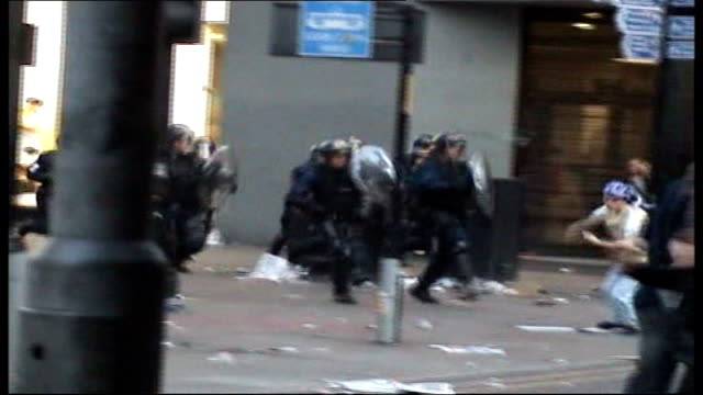 Glasgow Rangers lose to Zenit St Petersburg ENGLAND Manchester EXT Riot police running along street in pursuit of Glasgow Rangers fans