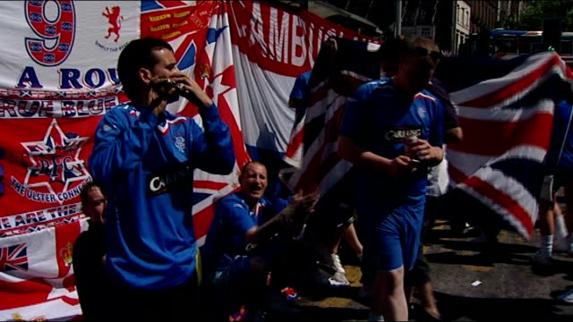 Glasgow Rangers lose to Zenit St Petersburg ENGLAND Manchester EXT Rangers fan playing musical instrument SOT Crowds of Rangers fans many holding...