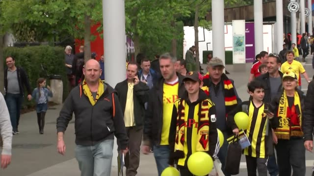 Manchester City v Watford preview ENGLAND London Wembley Stadium EXT Reporter to camera SOT CUTAWAY general views of Watford FC fans along to Wembley