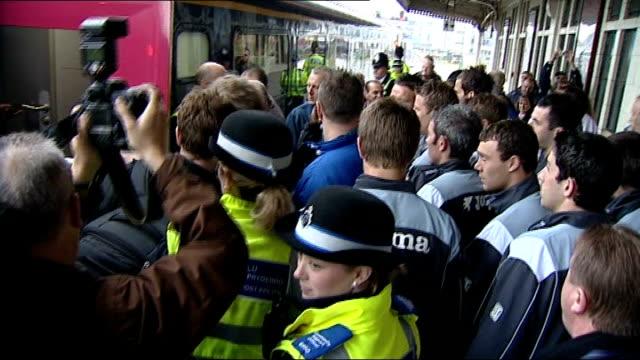 Cardiff Cardiff City FC boarding train including Jimmy Floyd Hasselbaink and train leaving platform Fans chanting on train platform