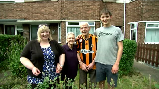arsenal face hull city; england: east yorkshire: hull: ext 93-year-old hull supporter sherard pearson standing in front garden with his wife sylvia,... - final round stock videos & royalty-free footage