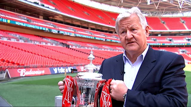 stockvideo's en b-roll-footage met arsenal face hull city wembley stadium kevin williams interview sot cutaway close shot trophy being held - fa cup