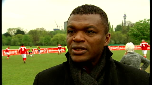 london regents park ext various of marcel desailly and ian rush posing for photocall with fa cup close shot fa cup trophy marcel desailly interview... - コブハム点の映像素材/bロール