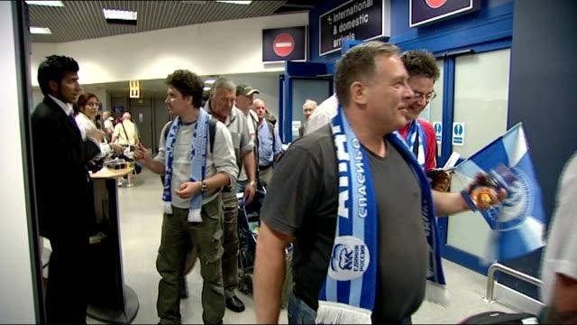 Rangers fans arrive in Manchester ENGLAND Manchester INT Zenit fans arriving at airport