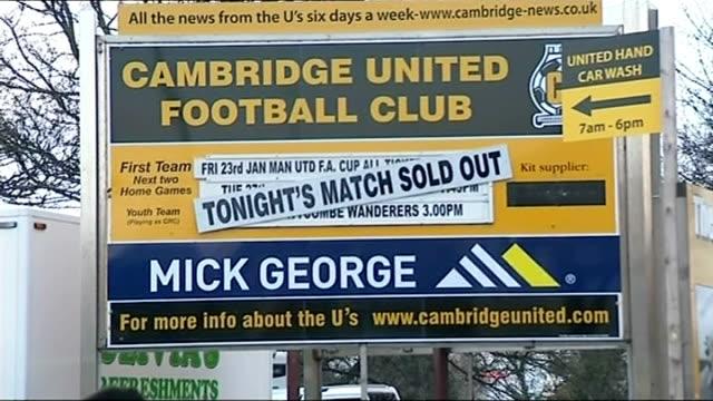 cambridge united v manchester united england cambridge abbey stadium cambridge supporters standing outside statium ahead of match man along through... - bacheca video stock e b–roll