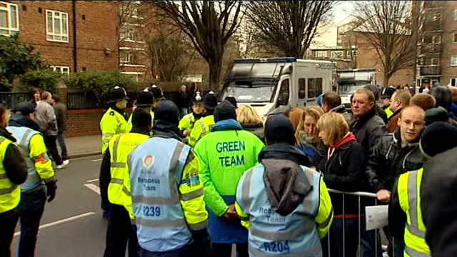heightened security at fa cup ties ext police riot vans along through security / close up of police officers / chelsea team coach arriving to chants... - クイーンズ パーク レンジャーズfc点の映像素材/bロール