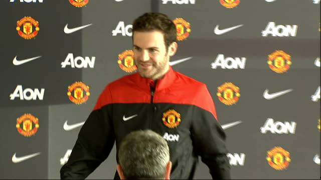 stockvideo's en b-roll-footage met cup fourth round matches; england: manchester: int juan mata along at press conference mata and david moyes holding mata number 8 red jersey at press... - number 8