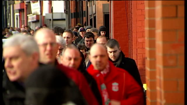 merseyside liverpool anfield ext fans milling about outside anfield stadium ahead of liverpool v manchester united fa cup fourth round match... - fence stock videos & royalty-free footage