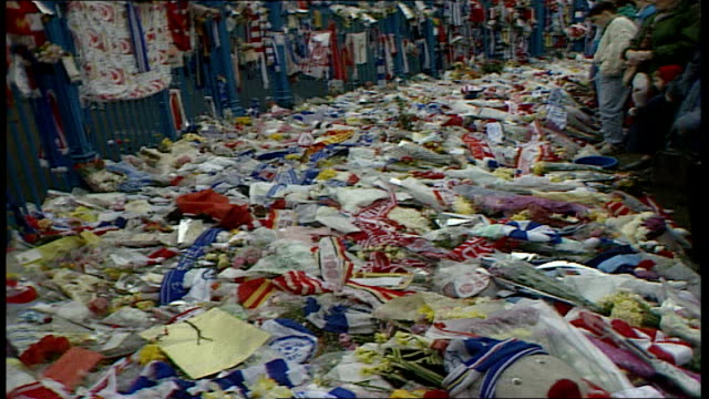 cup hillsborough disaster: aftermath; england: south yorkshire: sheffield: hillsborough: ext makeshift memorial by gates of stadium including... - sheffield stock videos & royalty-free footage