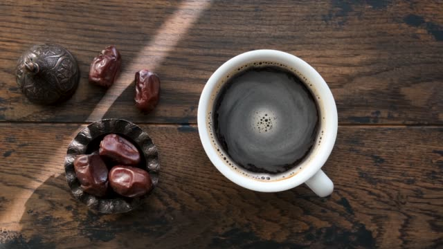 cup of black coffee and dry dates - pistazie stock-videos und b-roll-filmmaterial