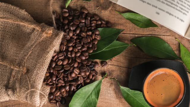 cup of coffee and coffee beans - sack stock videos & royalty-free footage
