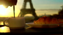 Cup of coffee with a croissant in Paris
