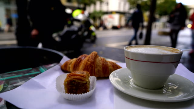 cup of fresh hot coffee and traditional french croissant - patio stock videos & royalty-free footage