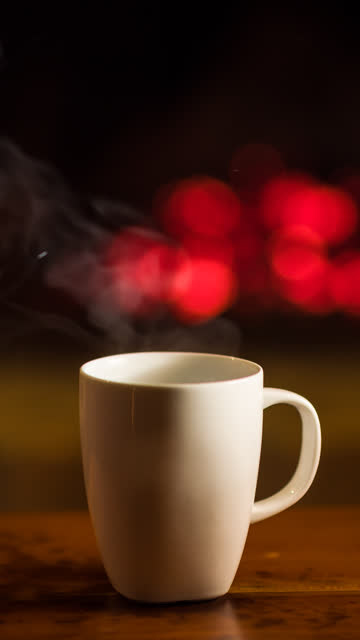 cup of hot beverage in front of a fireplace - rustic stock videos & royalty-free footage