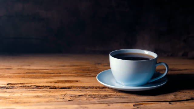 cup of hot coffee on table - tea cup stock videos & royalty-free footage