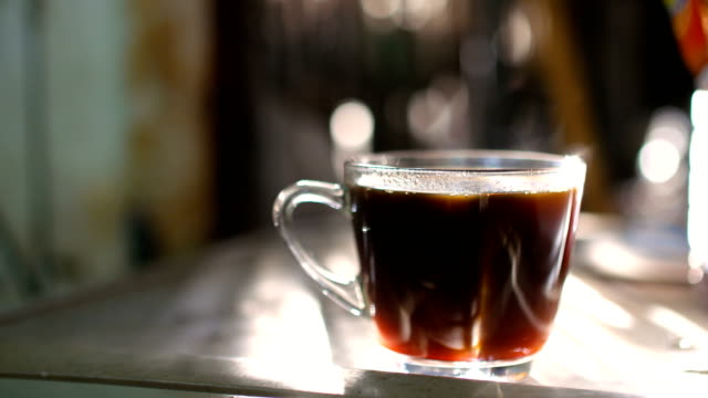 A Cup of Hot Coffee with Stream and Beautiful Sunlight