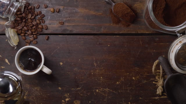a cup of hot fresh coffee on a wooden table - table top view stock videos & royalty-free footage
