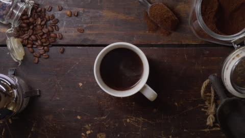 a cup of hot fresh coffee on a wooden table - coffee cup stock videos & royalty-free footage