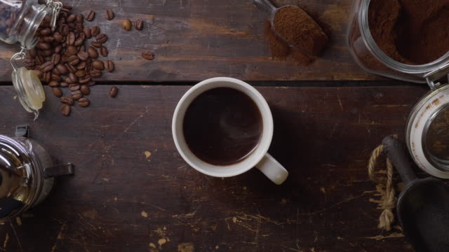a cup of hot fresh coffee on a wooden table - cup stock videos & royalty-free footage