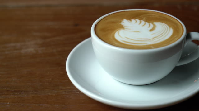 cup of hot latte coffee