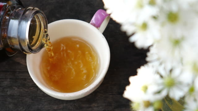 cup of tea brewing tea for relax time , 4k(uhd) - tea cup stock videos & royalty-free footage