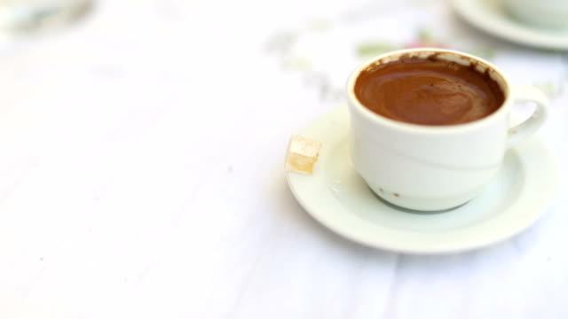 stockvideo's en b-roll-footage met kopje turkse koffie op een café tafel geserveerd met turks fruit - turks fruit