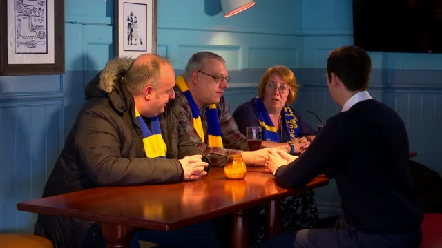 Preview of AFC Wimbledon v Tottenham London INT Reporter chatting to fans Stuart Young interview SOT