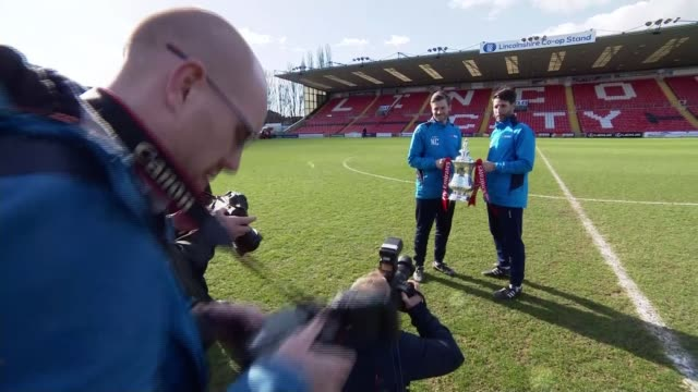 lincoln city prepare for arsenal match c3 england lincoln sincil bank ext lincoln city players photocall standing on pitch holding fa cup trophy/... - fototermin stock-videos und b-roll-filmmaterial