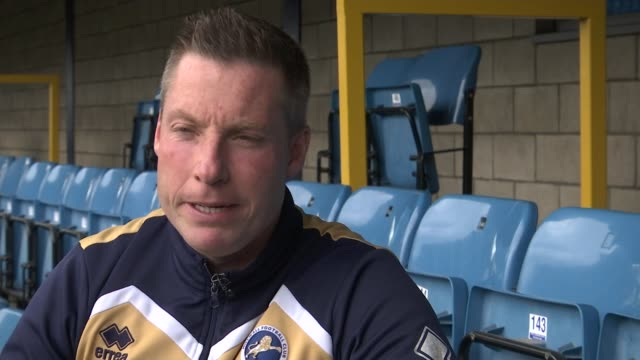 Millwall prepare for match against Spurs London EXT Neil Harris set up shot / interview SOT Millwall players including Ben Thompson training INT...