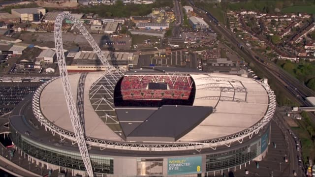 stockvideo's en b-roll-footage met reading vs arsenal england london wembley stadium view aerial of wembley stadium with video screen showing spectators - fa cup