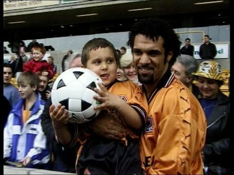 wolverhampton molineux ext wolverhampton wanderers players posing with supporters and signing autographs keith curle intvwd if arsenal play to the... - autogramm stock-videos und b-roll-filmmaterial